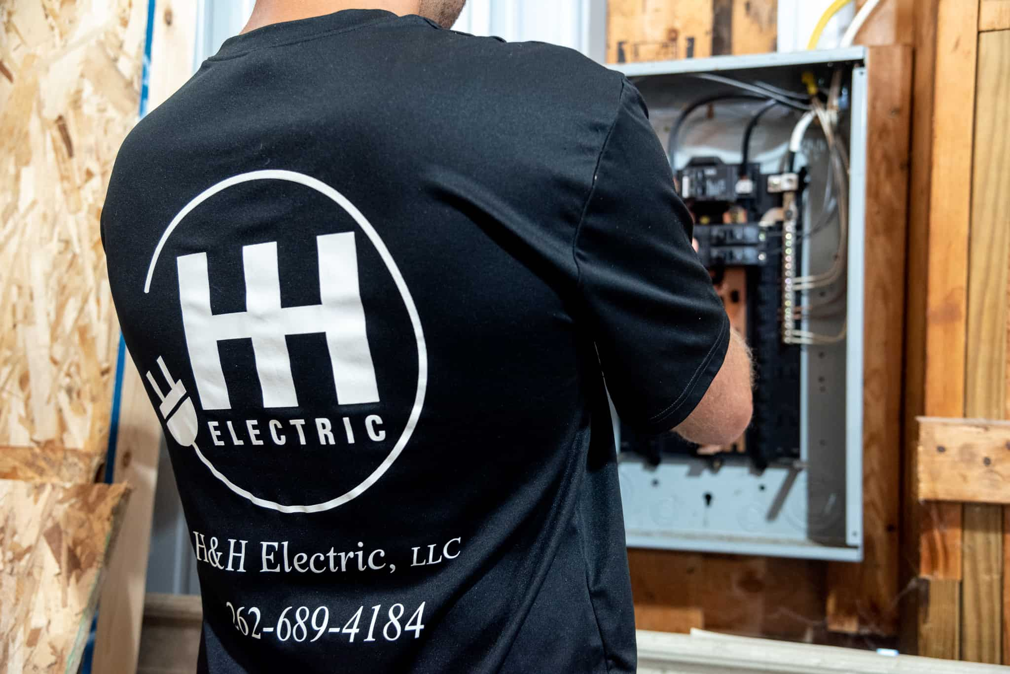 H&H Master Electrician Performing Work In Breaker Panel for Home Inspection Repair