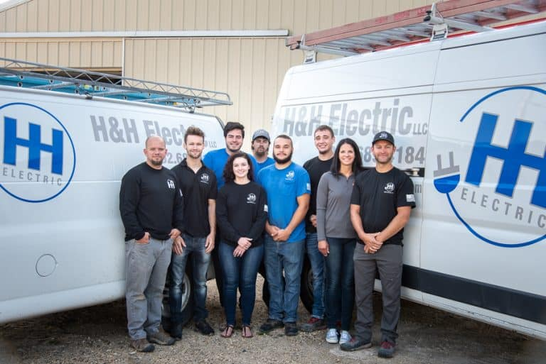 Kewaskum Electrician, H&H Electric, and Team of Certified Electricians In Front of Vans at Kewaskum Shop